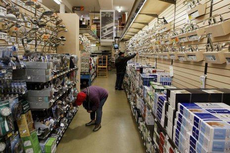 Shoppers look for items in the home improvement department of a Home Depot store in New York April 13, 2011. REUTERS/Lucas Jackson