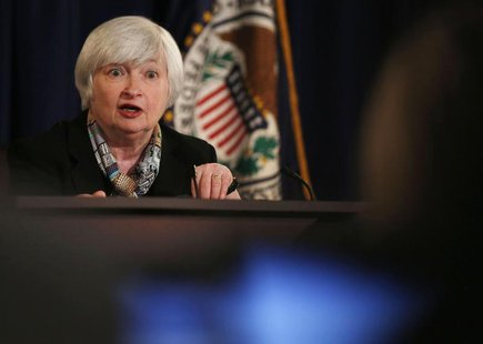 Federal Reserve Chair Janet Yellen addresses a question at a news conference following the March 2014 Federal Open Market Committee meeting,