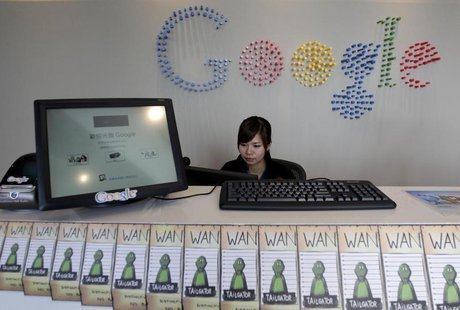 An employee sits behind a reception desk during a media tour in the Google data centre in Changhua Coastal Industrial Park, central Taiwan,
