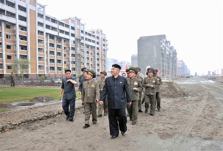 North Korean leader Kim Jong-un inspects the construction site of the apartment houses for scientists close to completion in this undated fi