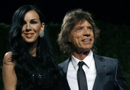 Designer L'Wren Scott and rock musician Mick Jagger pose as they arrive at the 2009 Vanity Fair Oscar Party in West Hollywood, California Fe