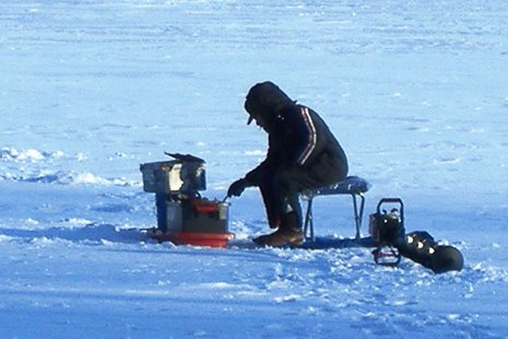 A person ice fishing.