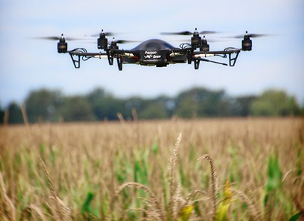 Drone made by Precision Drones of Indiana over a corn field