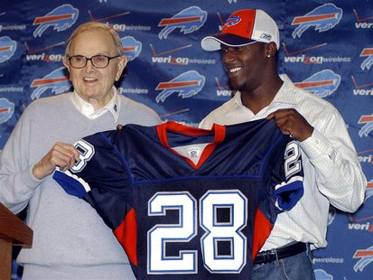 Buffalo Bills owner Ralph Wilson (L) appears during a news conference with Bills NFL first round draft pick Leodis McKelvin, a defensive bac