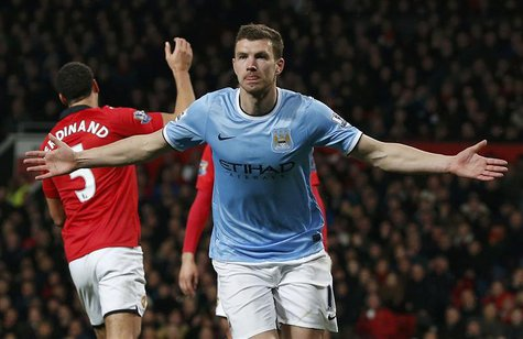 Manchester City's Edin Dzeko celebrates his second goal against Manchester United during their English Premier League soccer match at Old Tr