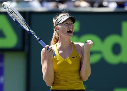 Mar 25, 2014; Miami, FL, USA; Maria Sharapova celebrates after her match against Petra Kvitova (not pictured) on day nine of the Sony Open a
