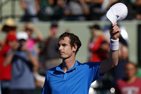 Mar 25, 2014; Miami, FL, USA; Andy Murray waves to the crowd after his match against Jo-Wilfried Tsonga (not pictured) on day nine of the So