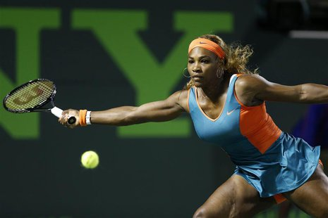 Mar 25, 2014; Miami, FL, USA; Serena Williams hits a forehand against Angelique Kerber (not pictured) on day nine of the Sony Open at Crando
