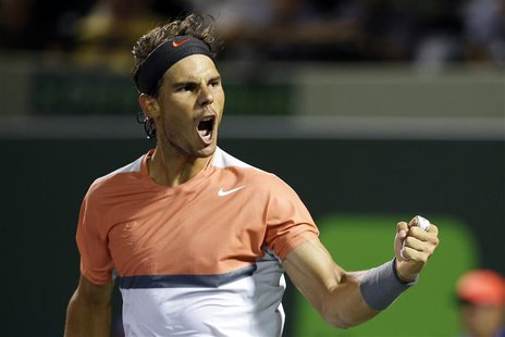 Mar 25, 2014; Miami, FL, USA; Rafael Nadal celebrates after his match against Fabio Fognini (not pictured) on day nine of the Sony Open at C