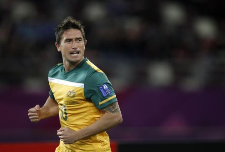 Australia's Harry Kewell celebrates after scoring against Uzbekistan during their 2011 Asian Cup semi-final soccer match at Khalifa stadium