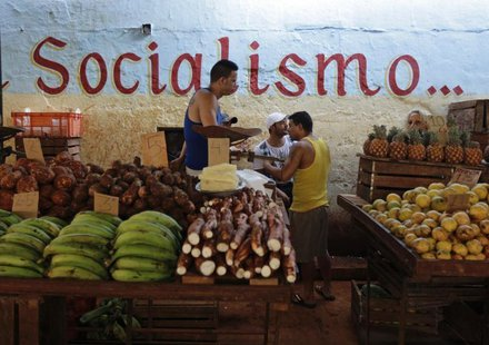 Vendors wait for customers at their stalls, with prices tagged in Cuban pesos, at a market in Havana October 23, 2013. REUTERS/Desmond Boyla