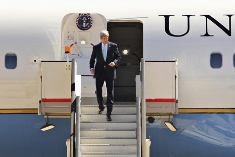 U.S. Secretary of State John Kerry leaves his plane as he arrives in Amman March 26, 2014. REUTERS/Muhammad Hamed