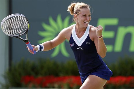 Mar 26, 2014; Miami, FL, USA; Dominika Cibulkova celebrates after her match against Agnieszka Radwanska (not pictured) on day ten of the Son