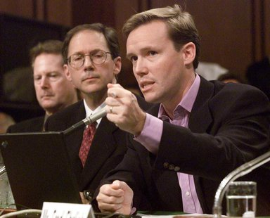 Michael Robertson (R), CEO of MP3.com, testifies before a Senate Judiciary committee on Capital Hill on the future of digital music, July 11
