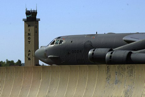 A B-52H with the 5th Bomb Wing taxis past the Minot AFB control tower. By U.S. Air Force photo/Master Sgt. Lance Cheung [Public domain], via Wikimedia Commons