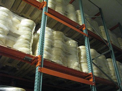 Cheese wheels in cold storage