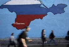 People pass by a mural of Crimea in Russian colors on a street in Moscow. REUTERS Arthur Bainozarov