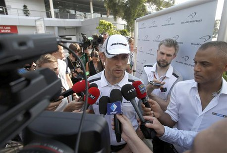 McLaren Formula One driver Jenson Button of Britain speaks to journalists ahead of the Malaysian F1 Grand Prix at Sepang International Circu