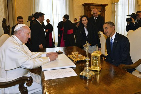U.S. President Barack Obama (R) talks with Pope Francis during a private audience at the Vatican March 27, 2014. REUTERS/Gabriel Bouys/Pool