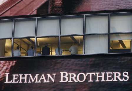 People sit in the window at the Lehman Brothers building in New York September 15, 2008. REUTERS/Joshua Lott