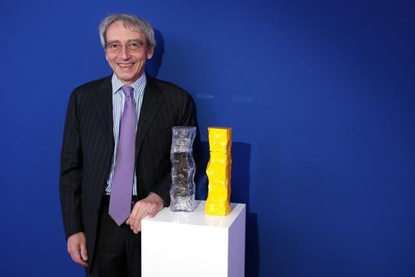 Pierre Pringuet, Chief Executive Officer of French drinks maker Pernod Ricard, poses before the presentation of the group's 2013/14 half-yea