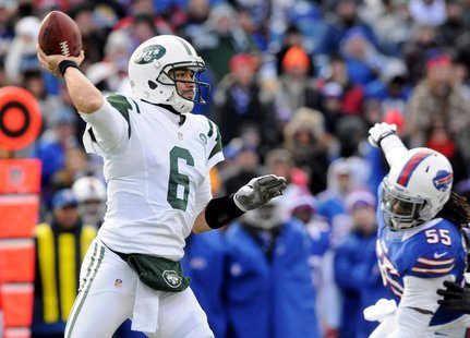 New York Jets quarterback Mark Sanchez (6) is back to pass against Buffalo Bills linebacker Kelvin Sheppard (55) in the first quarter of the
