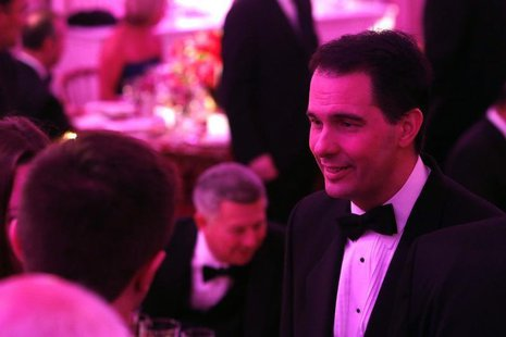 Wisconsin Governor Scott Walker (R-WI) (R) greets fellow guests before the 2014 Governors' Dinner in the State Dining Room of the White Hous