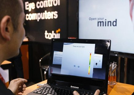 A Tobii Technology representative demonstrates what the Swedish company says is the world's first first eye-controlled laptop at the Consume