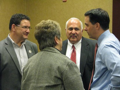 Rep. Bob Kulp (Left), Rep. John Spiros (center) Governor Scott Walker (right) Chamber Board Chairperson Lori Weyers (facing away)