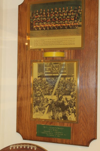 a piece of a goal post from the Ice Bowl