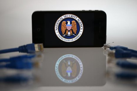 An illustration picture shows the logo of the U.S. National Security Agency on the display of an iPhone in Berlin, June 7, 2013. CREDIT: REUTERS/PAWEL KOPCZYNSKI