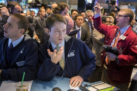 Traders work on the floor of the New York Stock Exchange March 21, 2014. REUTERS/Lucas Jackson
