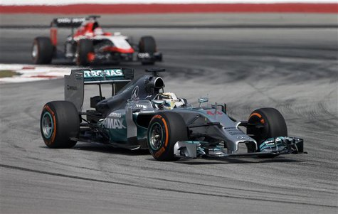 Mercedes Formula One driver Lewis Hamilton of Britain takes a corner during the first practice session of the Malaysian F1 Grand Prix at Sep