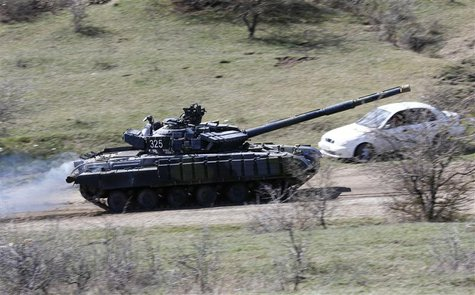 A tank, believed to be Russian, drives outside a military base in Perevalnoye, near the Crimean city of Simferopol, March 27, 2014. REUTERS/