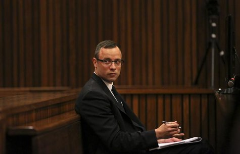 Olympic and Paralympic track star Oscar Pistorius sits in the dock during his trial for the murder of his girlfriend Reeva Steenkamp, at the