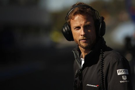 McLaren Formula One driver Jenson Button of Britain stands in the pit lane during pre-season testing at the Jerez racetrack in southern Spai