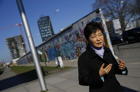 South Korean President Park Geun-hye looks at the exhibition 'DMZ-Gruenes Band' during a visit to the East Side Gallery in Berlin March 27,