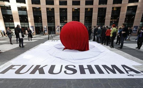 "A banner that reads ""Fukushima"" is placed in front of a giant symbolic Japan's national flag to mark the third year anniversary of the March"