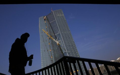 An American tourist stands under a bridge as he looks at the construction site of the new European Central Bank (ECB) headquarters in Frankf