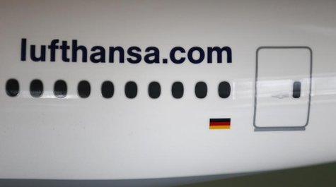 The web address of German air carrier Lufthansa AG is seen on a scale model of a Boing 777 aircraft during the company's annual news confere