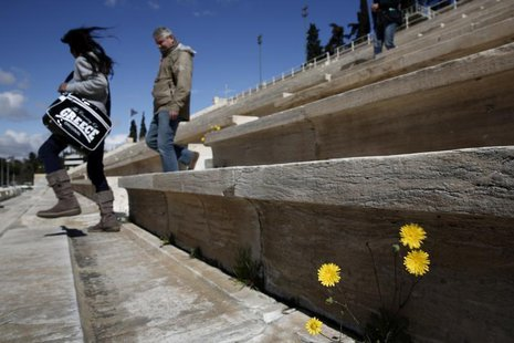 Tourists visit the Panathenean stadium, the stadium which hosted the first modern Olympics in 1896, in Athens March 11, 2014. REUTERS/Yorgos