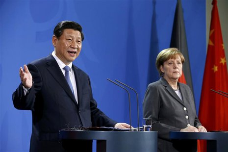 German Chancellor Angela Merkel and China's President Xi Jinping address a joint news conference after an agreement signing, at the Chancell
