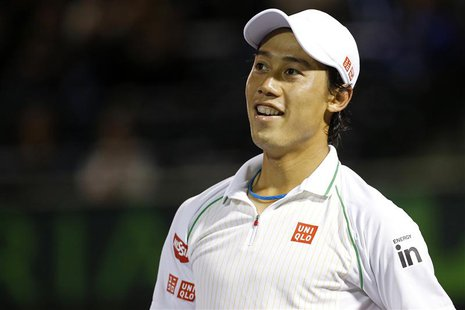 Mar 26, 2014; Miami, FL, USA; Kei Nishikori reacts against Roger Federer (not pictured) on day ten of the Sony Open at Crandon Tennis Center