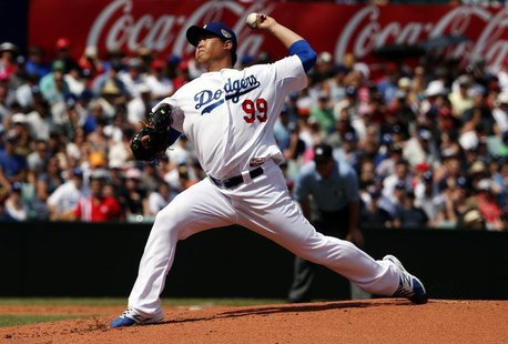 Los Angeles Dodgers pitcher Hyun-Jin Ryu throws a pitch against the Arizona Diamondbacks during the bottom of the second inning in their Maj