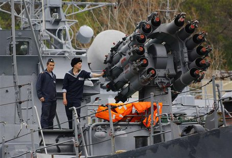 Sailors stand next to a weapons system onboard a Russian Navy vessel anchored at a navy base in the Ukrainian Black Sea port of Sevastopol i