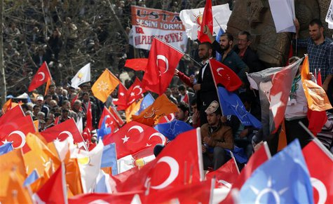 Supporters of the ruling AK Party wave Turkish and party flags during an election rally in Konya, central Turkey, March 28, 2014. REUTERS/Um