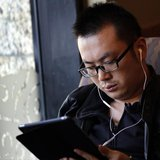 A man use his iPad inside a local coffee shop in downtown Shanghai November 28, 2013. REUTERS/Carlos Barria