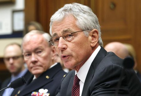 U.S. Secretary of Defense Chuck Hagel (R) and Chairman of the Joint Chiefs of Staff U.S. Army General Martin Dempsey (L) testify before the