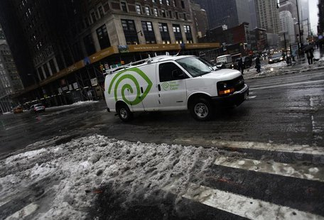 A Time Warner Cable van moves along 57th Street in New York February 13, 2014. REUTERS/Joshua Lott