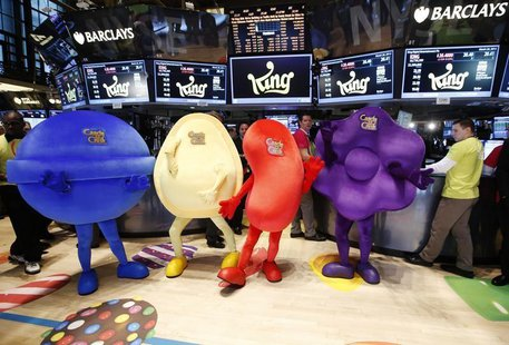 "Mascots dressed as characters from the mobile video game ""Candy Crush Saga"" pose during the IPO of Mobile game maker King Digital Entertainm"